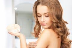 Beautiful woman with moisturizing creme Royalty Free Stock Photo