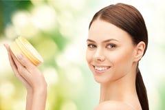 Beautiful woman with moisturizing creme Stock Photos