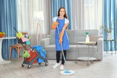 Beautiful woman mopping floor. At home Royalty Free Stock Image