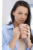 Beautiful woman with morning tea Royalty Free Stock Photo
