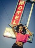 Beautiful woman motel sign Stock Photos
