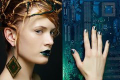 Beautiful woman with motherboard Stock Image