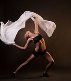 Beautiful woman in motion holding fabric Royalty Free Stock Images
