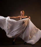 Beautiful woman in motion holding fabric Stock Image