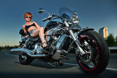 Beautiful woman and a motorbike Royalty Free Stock Images