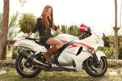 Beautiful woman on motorcycle Royalty Free Stock Image