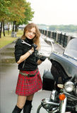Beautiful woman with motorcycle Royalty Free Stock Image