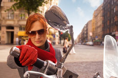 Beautiful woman on the motorcycle. (focus on the hand royalty free stock image