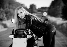 Beautiful woman on the motorcycle. black and white Royalty Free Stock Photography