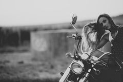 Beautiful woman on the motorcycle. royalty free stock photo