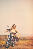 Beautiful woman on the motorcycle. Stock Photos