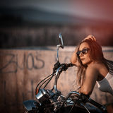 Beautiful woman on the motorcycle. Stock Image
