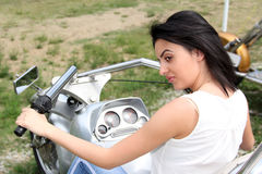 The beautiful woman on a motorcycle Stock Photography