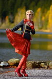 Beautiful woman by mountain lake in autumn Stock Images