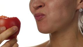 Beautiful woman mouth eating tomato. girl enjoying tasting tomato. healthy food and dieting concept. slow motion stock footage