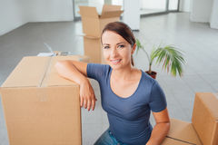 Beautiful woman moving in her new house Royalty Free Stock Photography