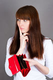 woman much thought holding a purse Royalty Free Stock Photos