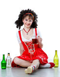 Beautiful woman with mug of beer and empty bottles Royalty Free Stock Photo