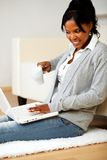 Beautiful woman with a mug in front of her laptop Royalty Free Stock Photography
