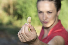 Beautiful woman with a mulberry. White mulberries are curant fruits Royalty Free Stock Photos