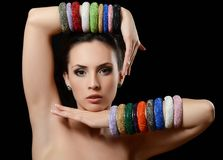 The beautiful woman in multi-coloured bracelet Royalty Free Stock Photography