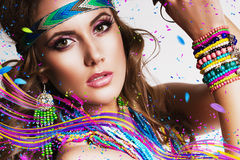 Beautiful woman with multi necklace and colourful lines royalty free stock image