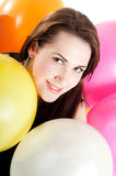Beautiful woman with multicolored air balloons Stock Photo