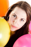 Beautiful woman with multicolored air balloons Stock Image
