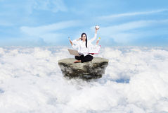 Beautiful woman multitasking above clouds Royalty Free Stock Image