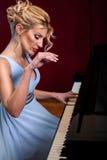 Beautiful woman musician piano music playing Royalty Free Stock Photography