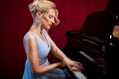 Beautiful woman musician piano music playing Royalty Free Stock Photos