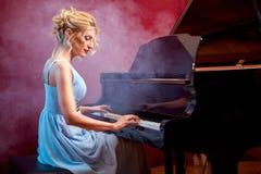 Beautiful woman musician piano music playing Stock Photo