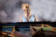 Beautiful woman musician piano music playing Stock Images