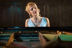 Beautiful woman musician piano music playing Royalty Free Stock Photo