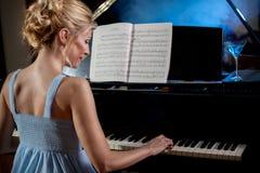 Beautiful woman musician piano music playing Stock Photography