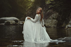 Beautiful woman in mystical waters royalty free stock photography