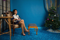Beautiful woman n the living room Royalty Free Stock Photography