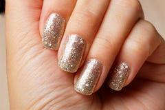 Beautiful woman nails manicure. Glittering Stock Image
