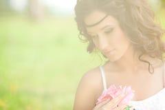 Beautiful woman on nature. Beautiful Young girl Outdoors. Enjoy Royalty Free Stock Photography