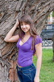 Beautiful woman on nature in a park. Young beautiful woman on nature in a park Stock Photos