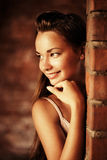 Beautiful woman near brick wall Royalty Free Stock Images