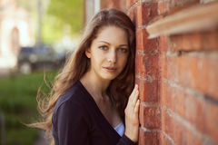 Beautiful woman near a brick wall Royalty Free Stock Photography