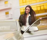 Beautiful woman near car Stock Image