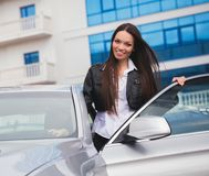 Beautiful woman near car Stock Photography
