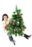 Beautiful woman near a Christmas tree Stock Photography