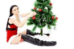 Beautiful woman near a Christmas tree Stock Image