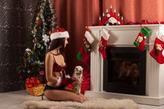 Beautiful woman near the fireplace in winter house. celebrating christmas Royalty Free Stock Image