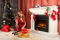 Beautiful woman near the fireplace in winter house. selebrating christmas Royalty Free Stock Photo