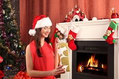 Beautiful woman near the fireplace in winter house. selebrating christmas Royalty Free Stock Photography