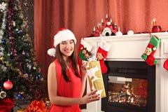 Beautiful woman near the fireplace in winter house. selebrating christmas Stock Image